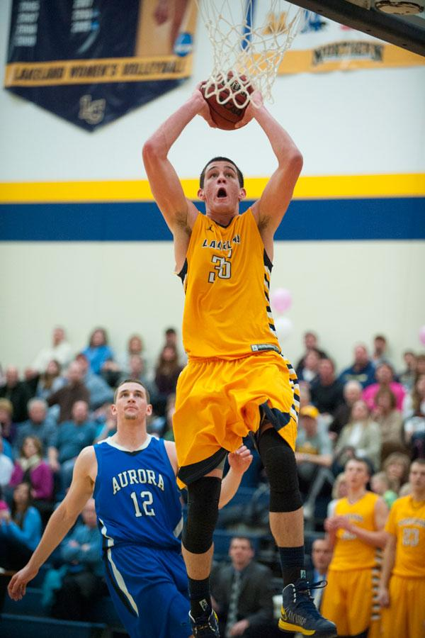 Justin Ward leaps to make a basket.