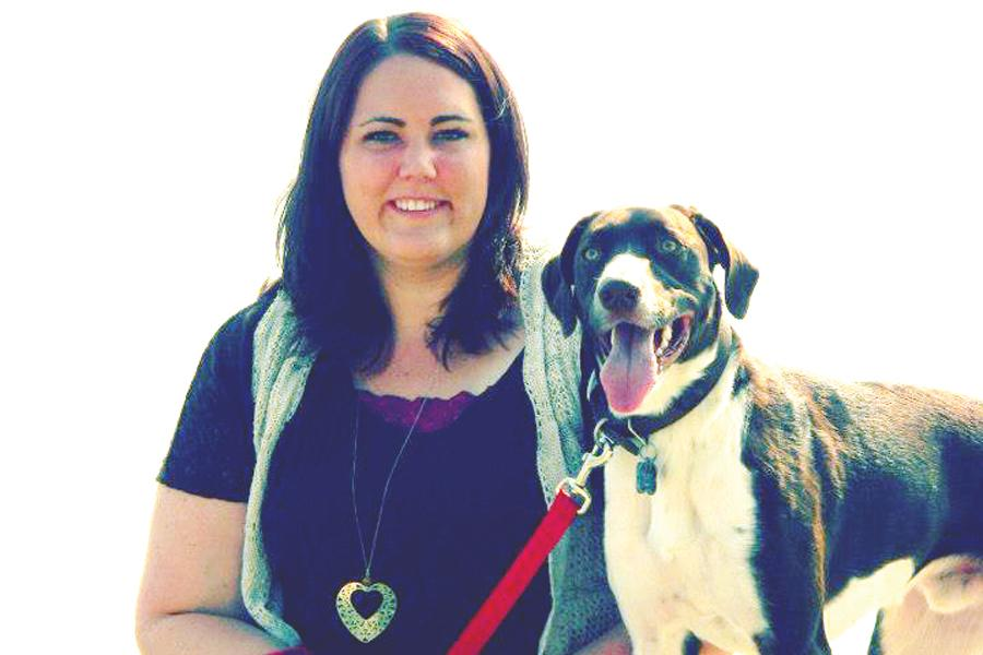 Brittaney Prosser and her dog, Blitz, on the Sheboygan beach.