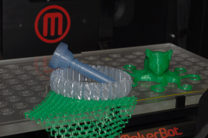 Computer science students work with 3D printer