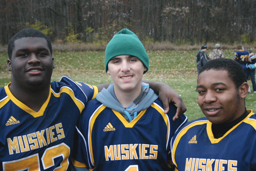 Noah, center, is an inspiration to adopted teammates and fellow Muskies.