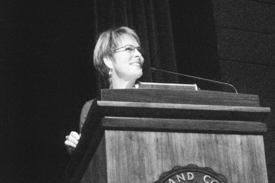 """Margaret Trost passionately speaks to the audience about the """"What If?"""" foundation."""