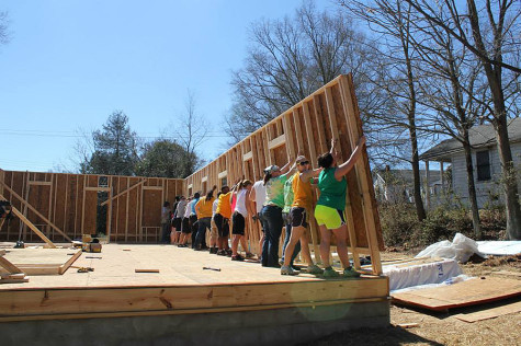 Habitat for Humanity volunteers joined forces to raise and support a wall while it was installed.