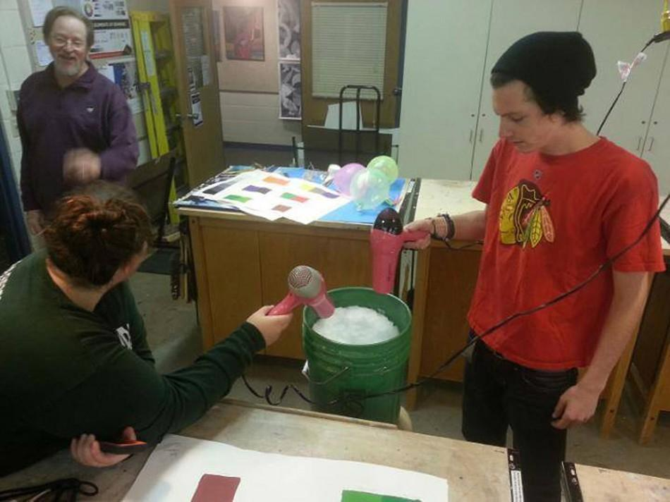 Art Teaching Techniques students melt snow for cleanup after a water main break.