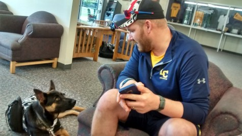 Army veteran Nick Marzahl, freshman psychology and nursing major, trains and uses the services of his service puppy, Duke, on campus.