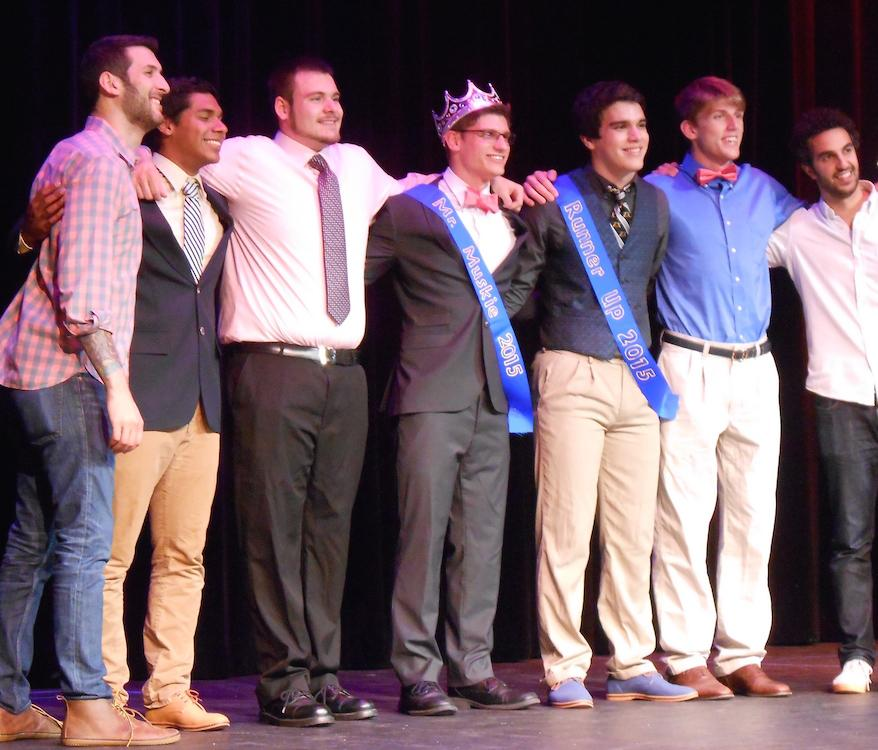 (Left to right): MC and comedian Ethan, junior criminal justice major Brandon Farmer, sophomore psychology and religion major Tyler Yost, freshman writing major and Mr. Muskie 2015 Dan Janeshek, junior marketing major and Mr. Muskie 2015 runner-up Aaron Almedina, psychology and criminal justice major Eddie Terres and MC and comedian Dave take a bow at the conclusion of the annual male talent show.