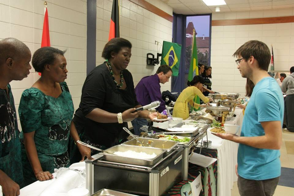 Students receive food from booths at last year's International Food Night. This year the annual event will take place Saturday, Oct. 24.