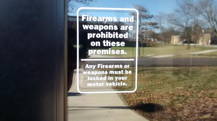 Signs like these can be seen all around campus reminding visitors that weapons are prohibited from the area.