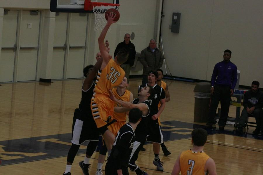 Tanner Hackl, senior graphic design major, goes up for a shot against Rockford.