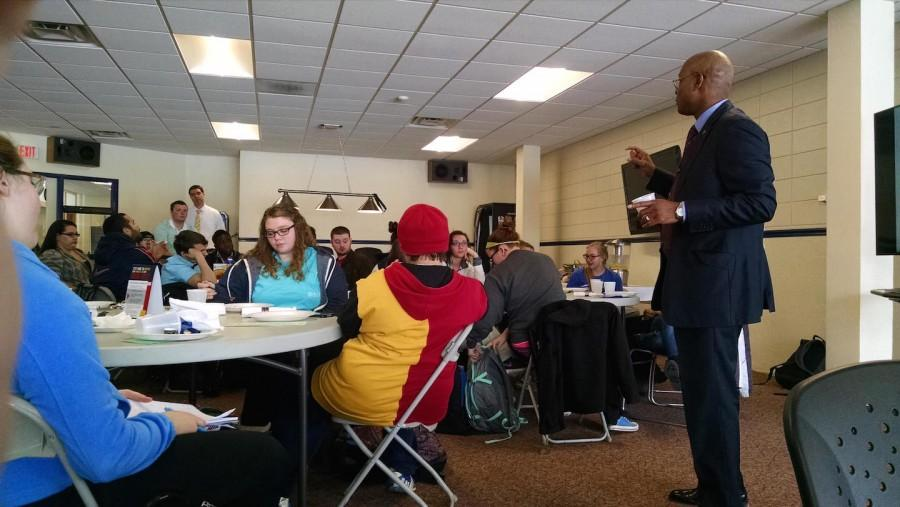 Associate Vice President for Student Success and Dean of Students, Eric Blacknall, talks to students about graduate school.