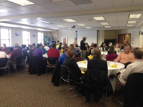 Prospective students speak with successful Lakeland alumni and faculty over lunch.
