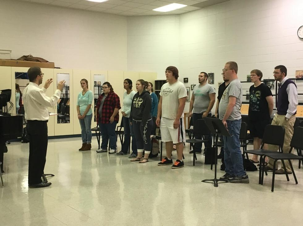 John Guarente, new assistant professor of music and director of choral activities, directs his choir.