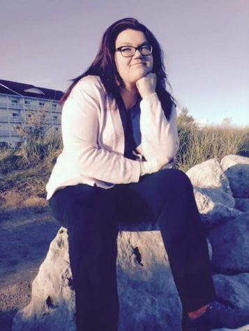 Mayce Bacon, senior writing major, enjoys the view at Blue Harbor as she ponders the mystery of the self.