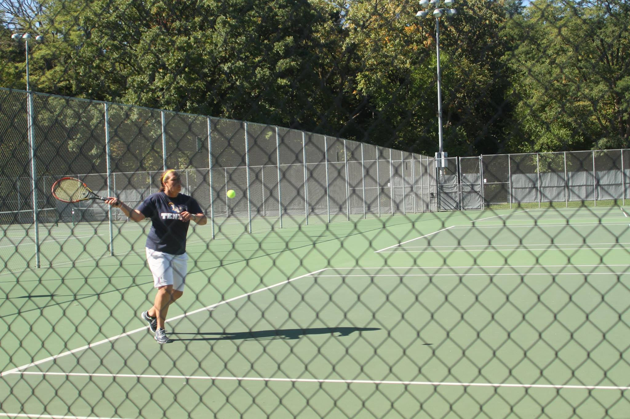Mikayla Hilton, senior sports management major, uses an aggressive forehand to win the point.