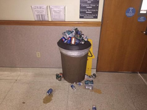 Custodians are people, too! A picture of the garbage can in the stairwell leading up to Lakeland University's cafeteria.