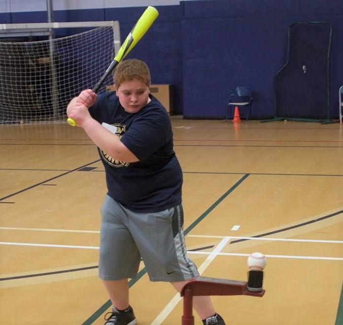 Baseball team hosts camp