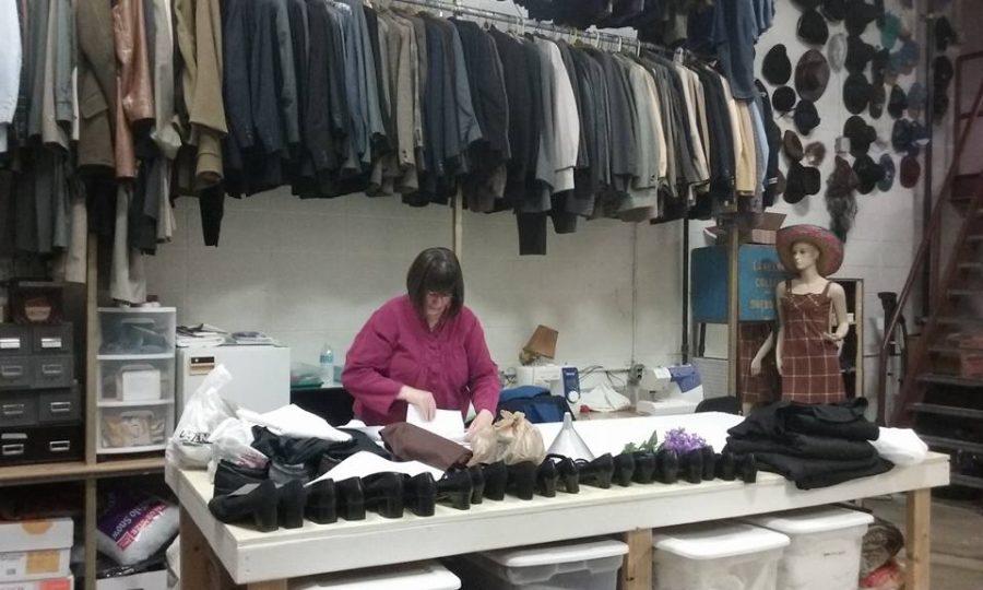 Della Jahnke, Bradley Theatre costume designer, works on costumes for the musical