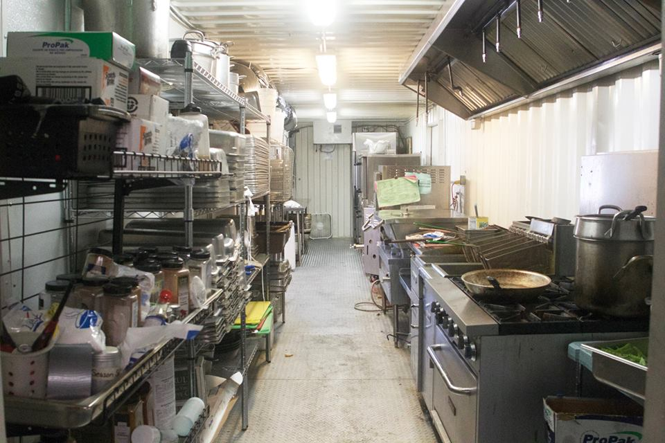 The new, smaller kitchen is kept out of plain view.